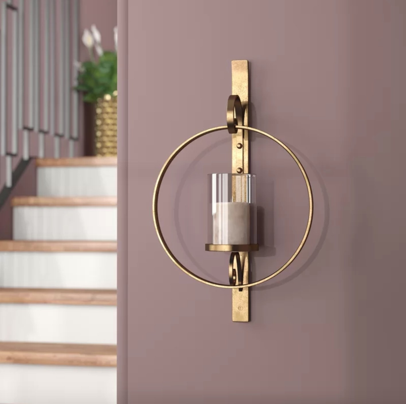 The wall sconce in gold