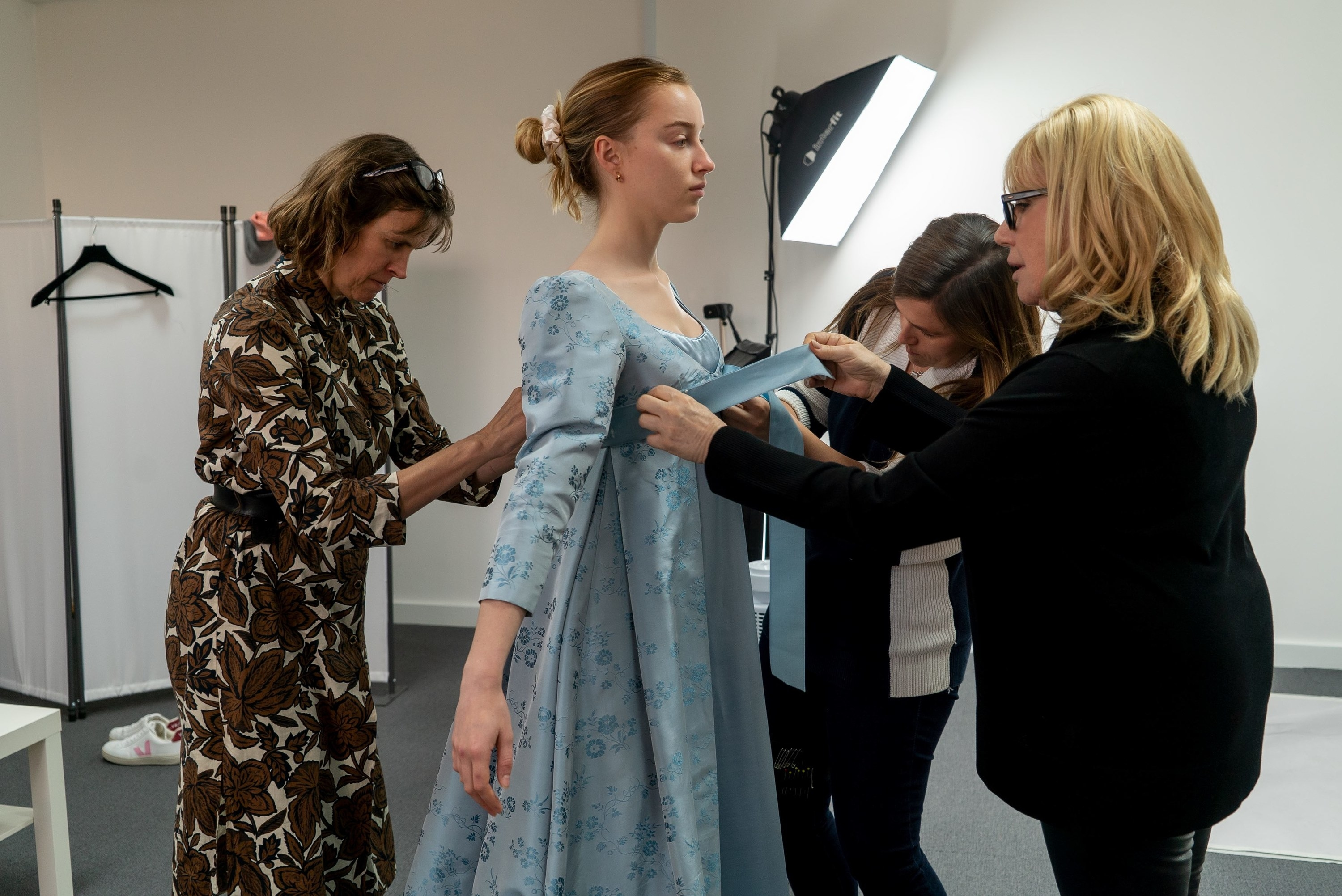 Phoebe Dynevor in a costume fitting for one of Daphne's dresses