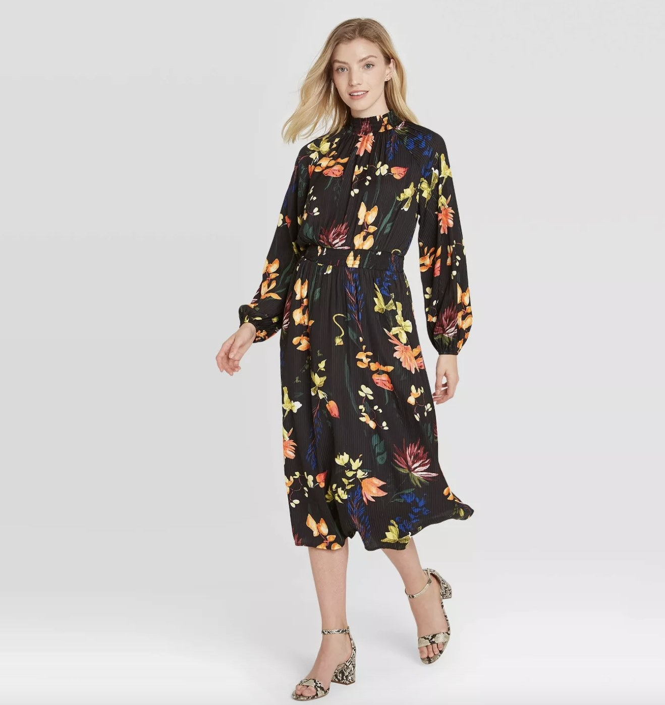 a black dress with colorful florals