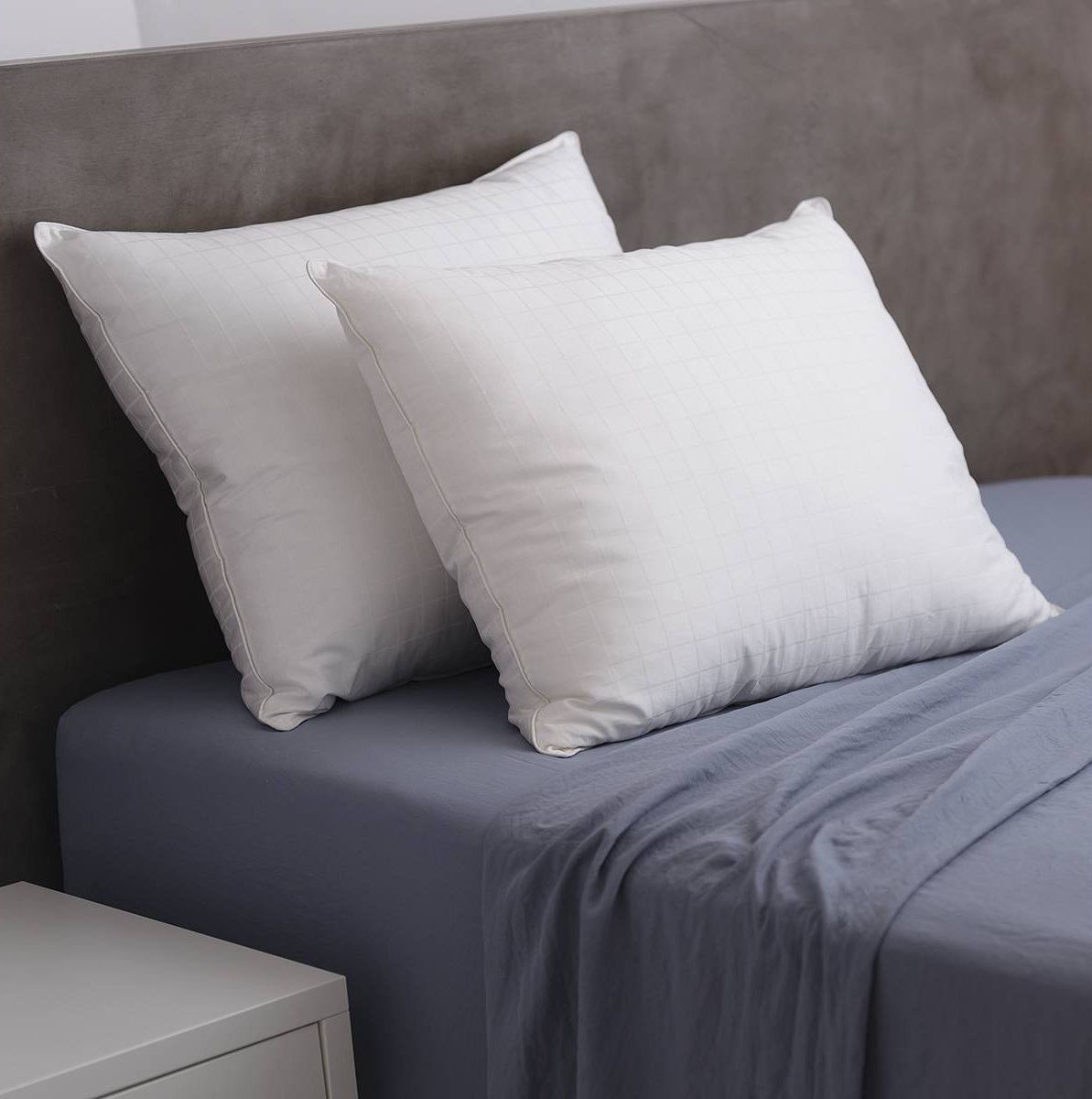The pillows, on a bed