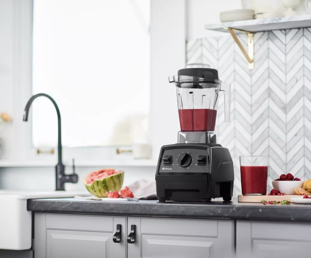 The Vitamix with a smoothie mixture inside it