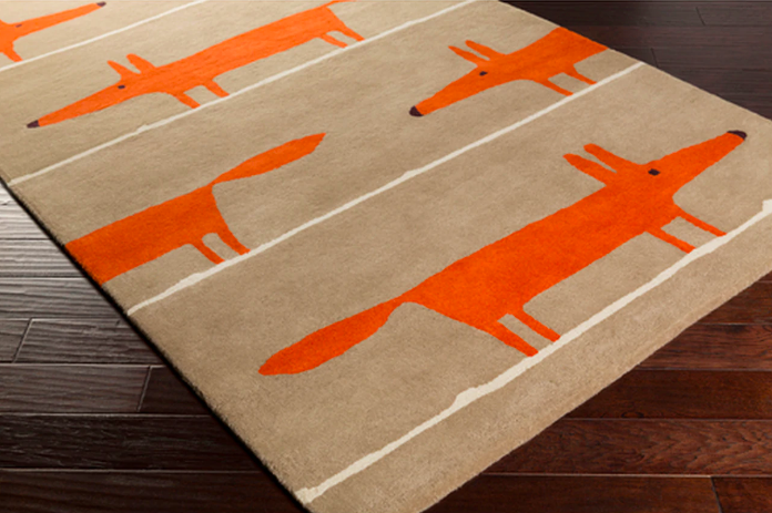 Tan rug with several minimalist foxes set in the pattern