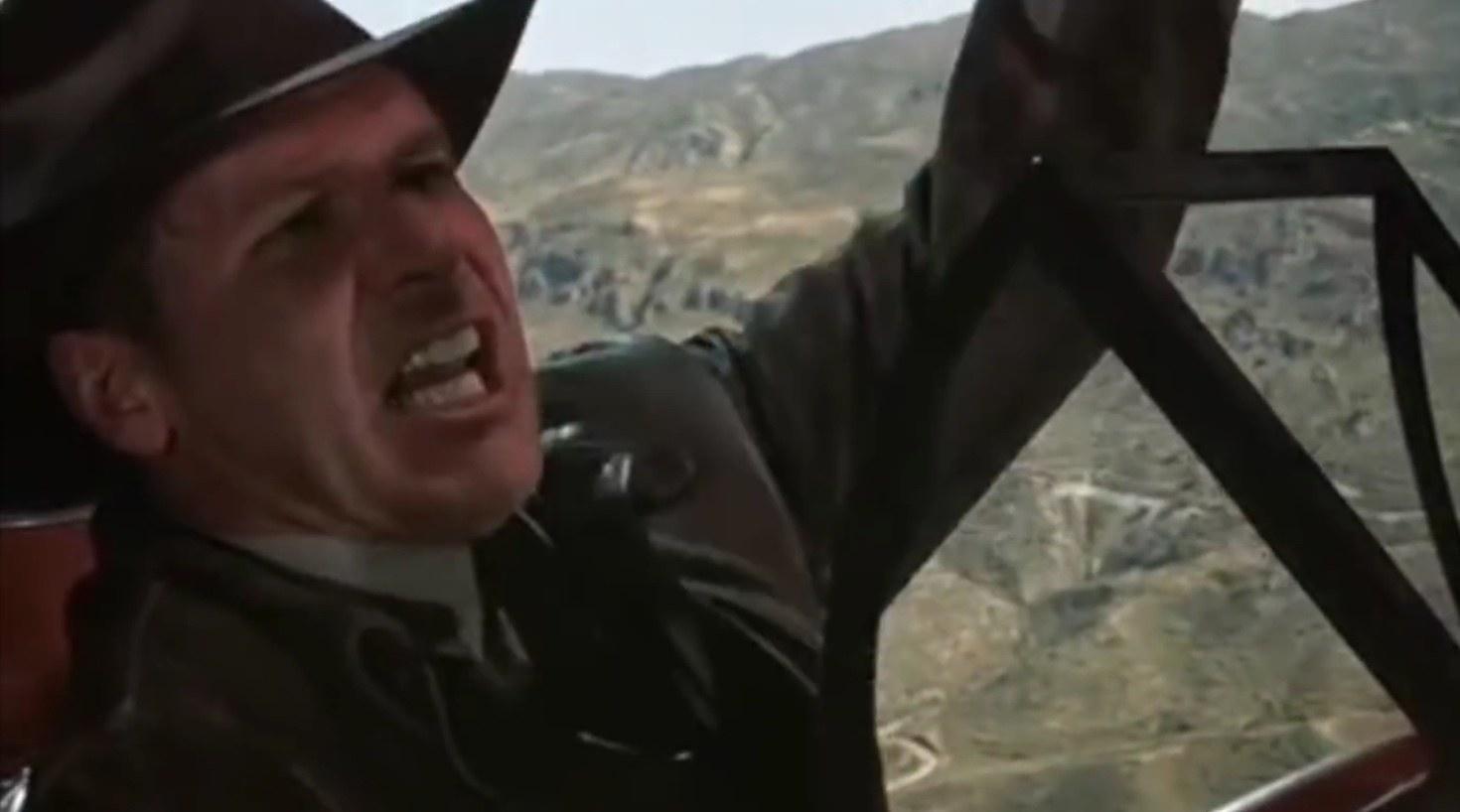 Indiana Jones angry on a plane.