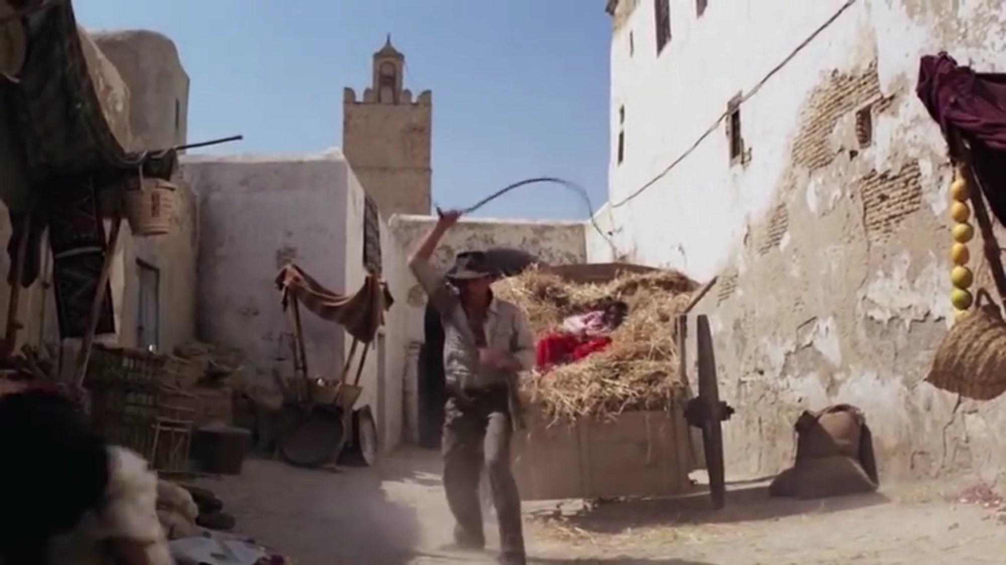 Indiana Jones using his whip.