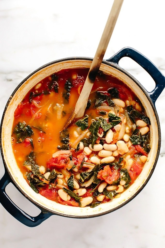 A big pot of kale and white bean stew in tomato broth.