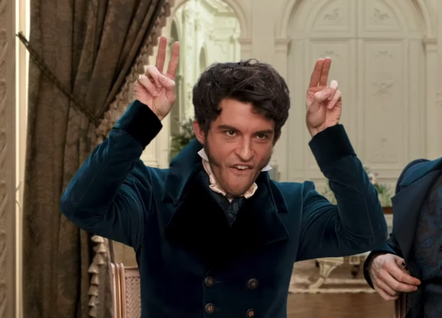Jonathan holding two fingers up in each hand by his hand as if to imitate ears
