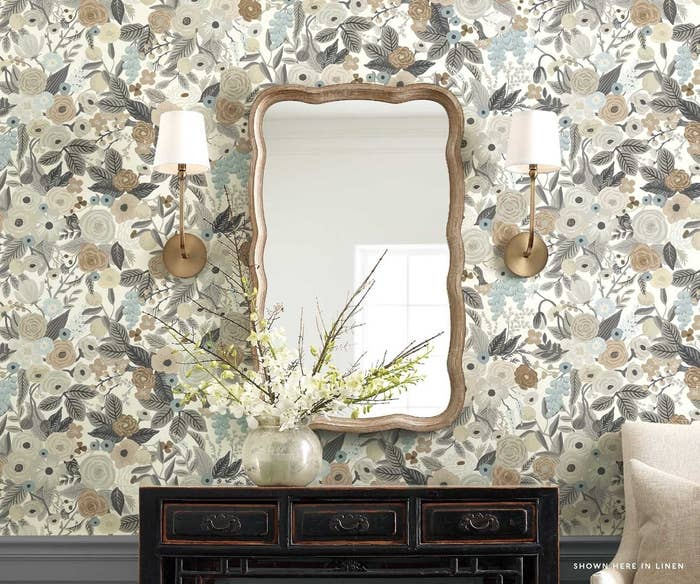 floral wallpaper in neutral colors on a wall