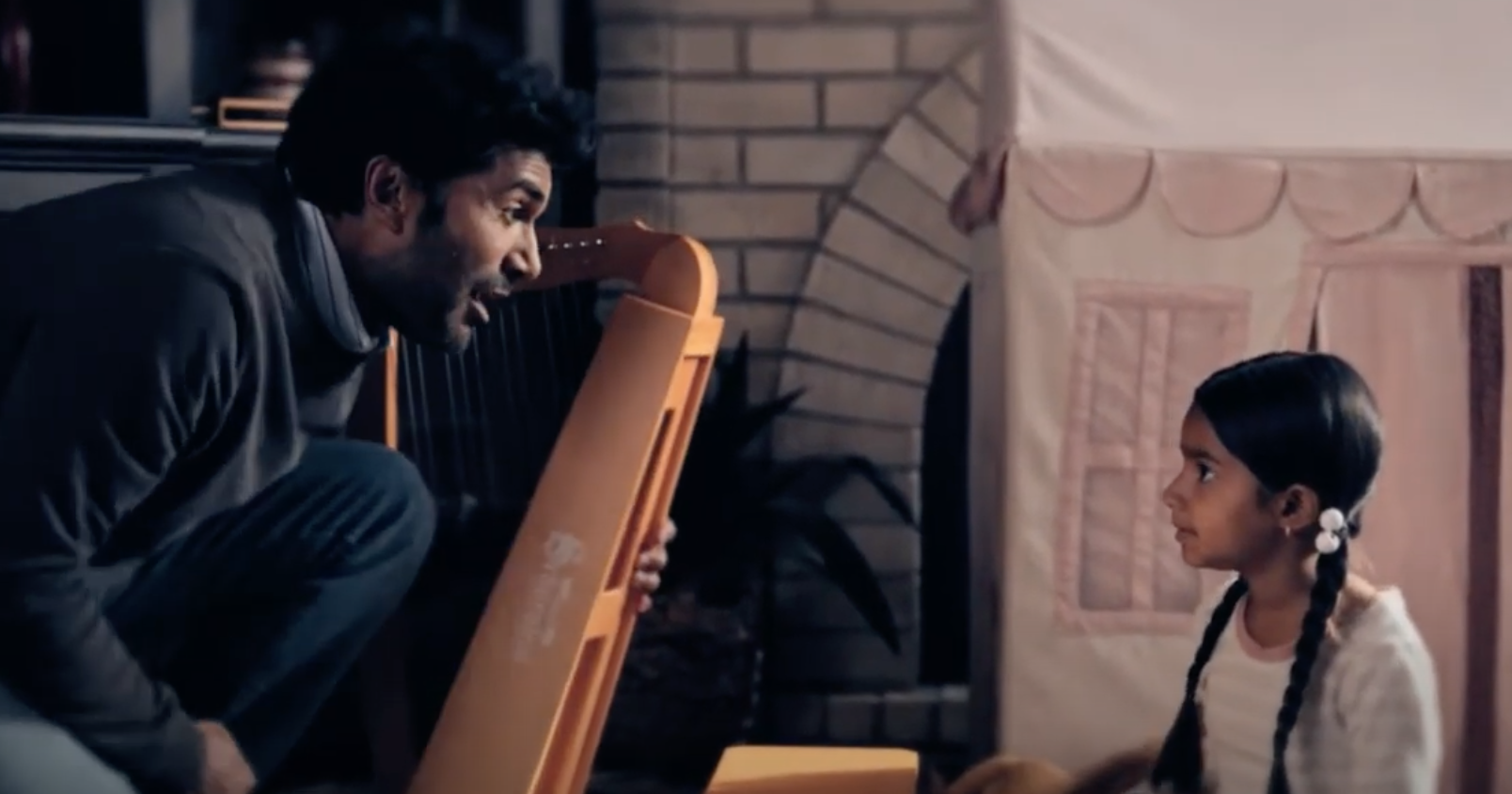 """Devi and her father with her first harp in """"Never Have I Ever"""""""