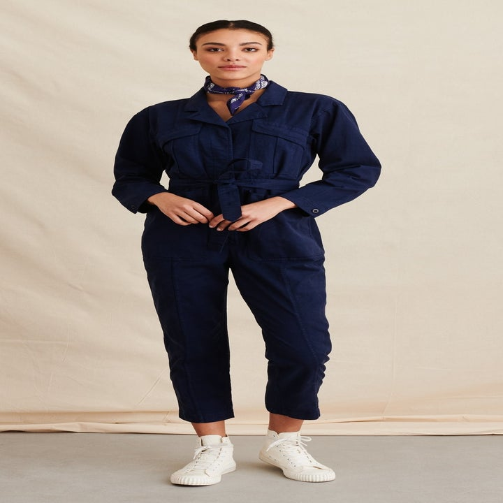 Front view of a model wearing the jumpsuit in dark navy