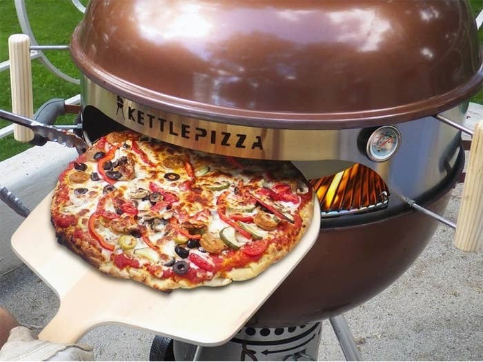 Kettle Pizza attachment attached to grill to make pizza oven