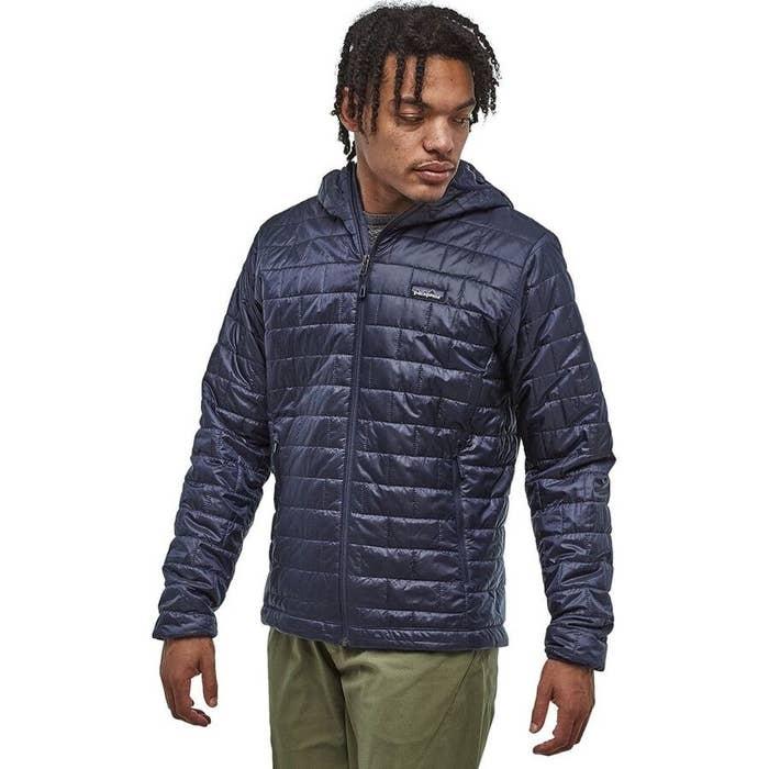 Model wearing navy Patagonia jacket