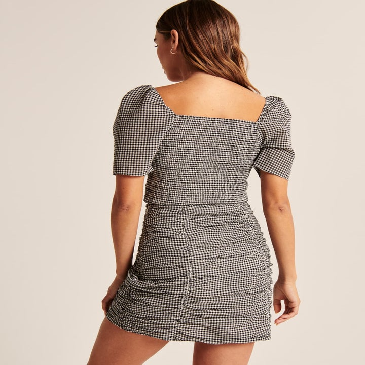 Back view of a model wearing the set in black and white check