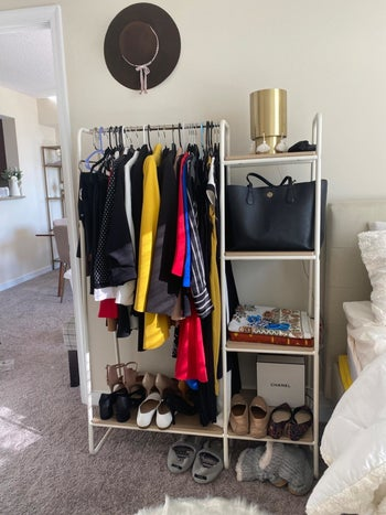 Reviewer uses same garment rack to display wardrobe essentials, including colorful jackets, dresses, and shoes, in their small bedroom
