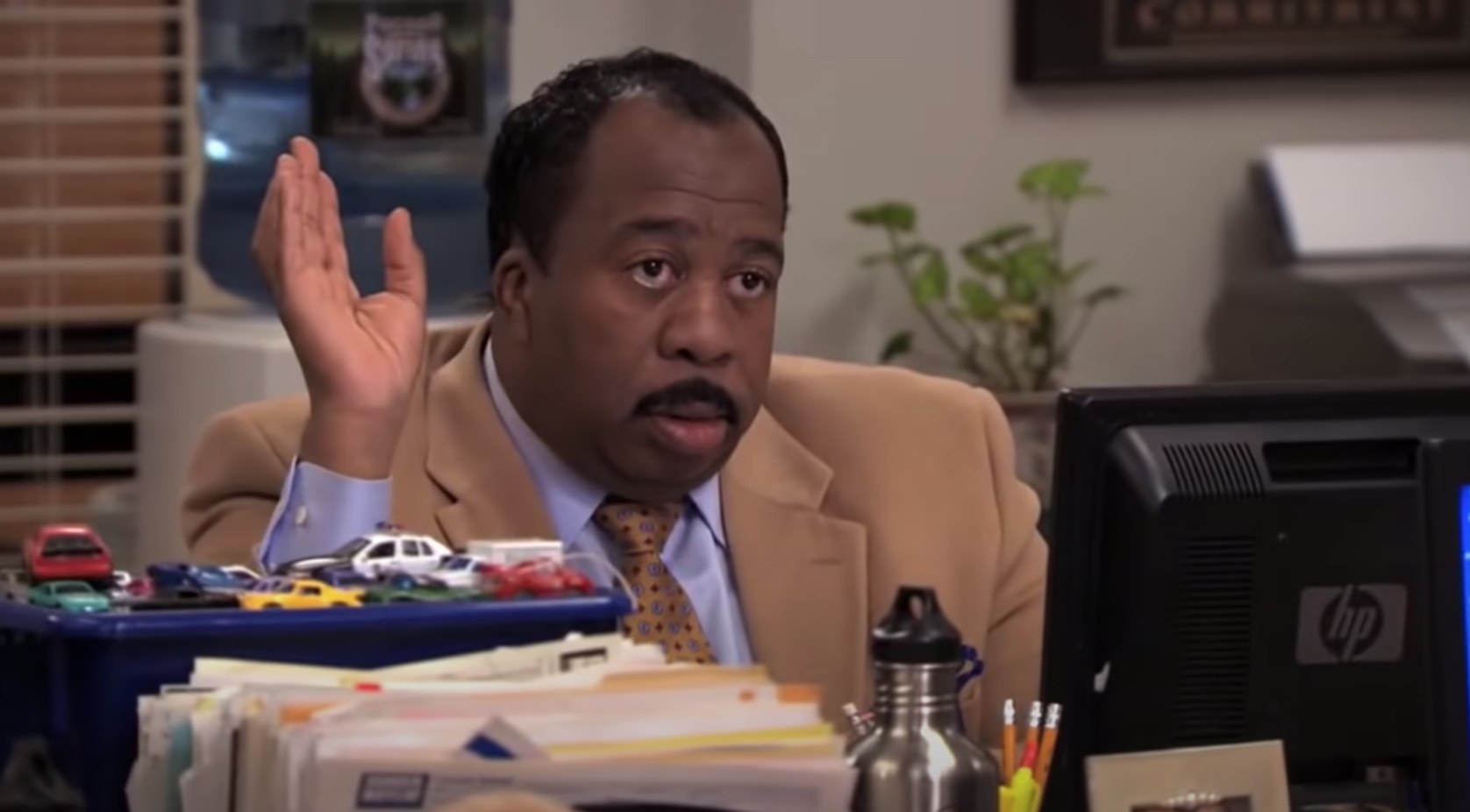 """Stanley from """"The Office"""" sitting at his desk"""