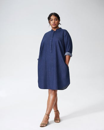 Front view of a model wearing the knee-length dress in dark indigo