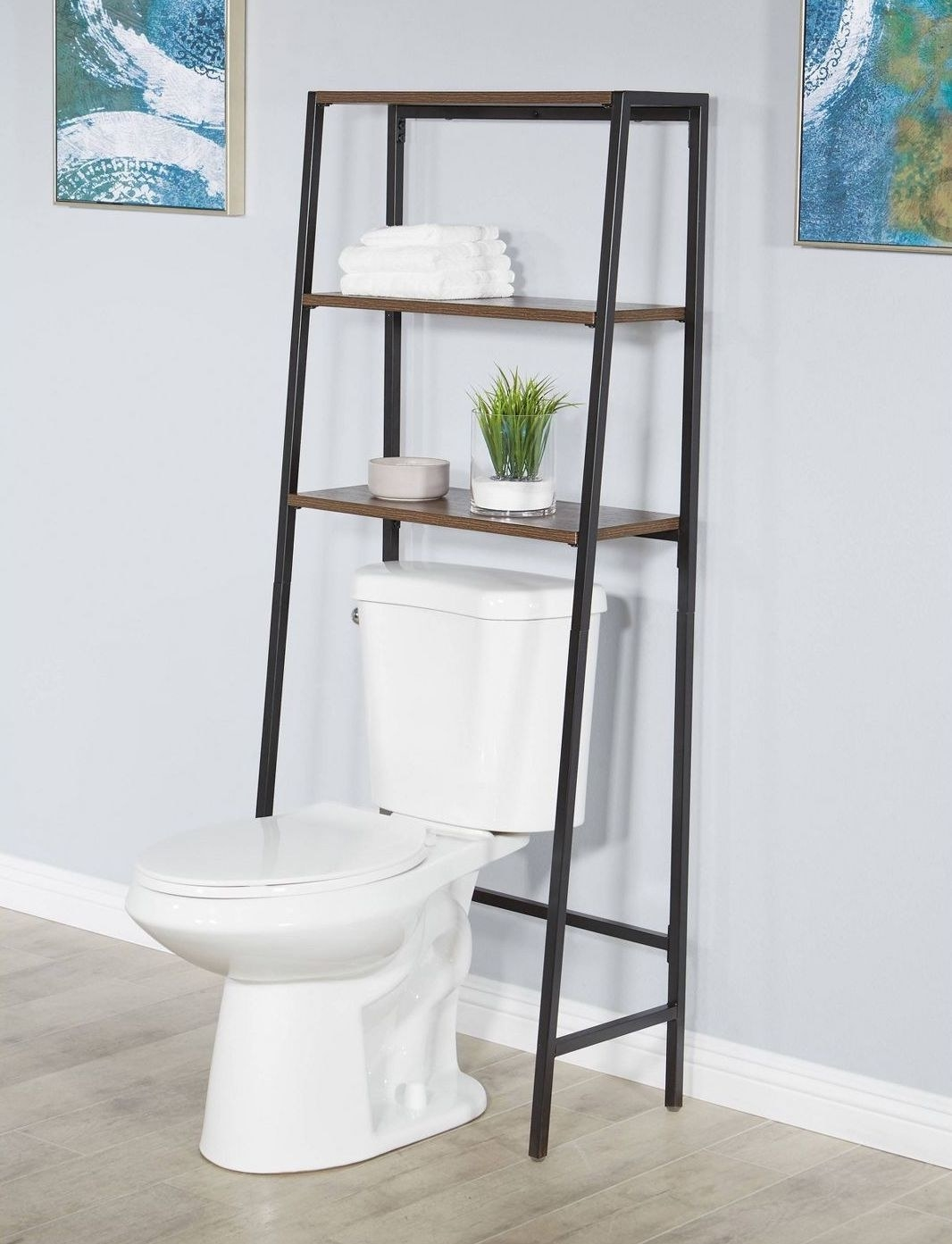 The gray and brown shelves, shown over a toilet