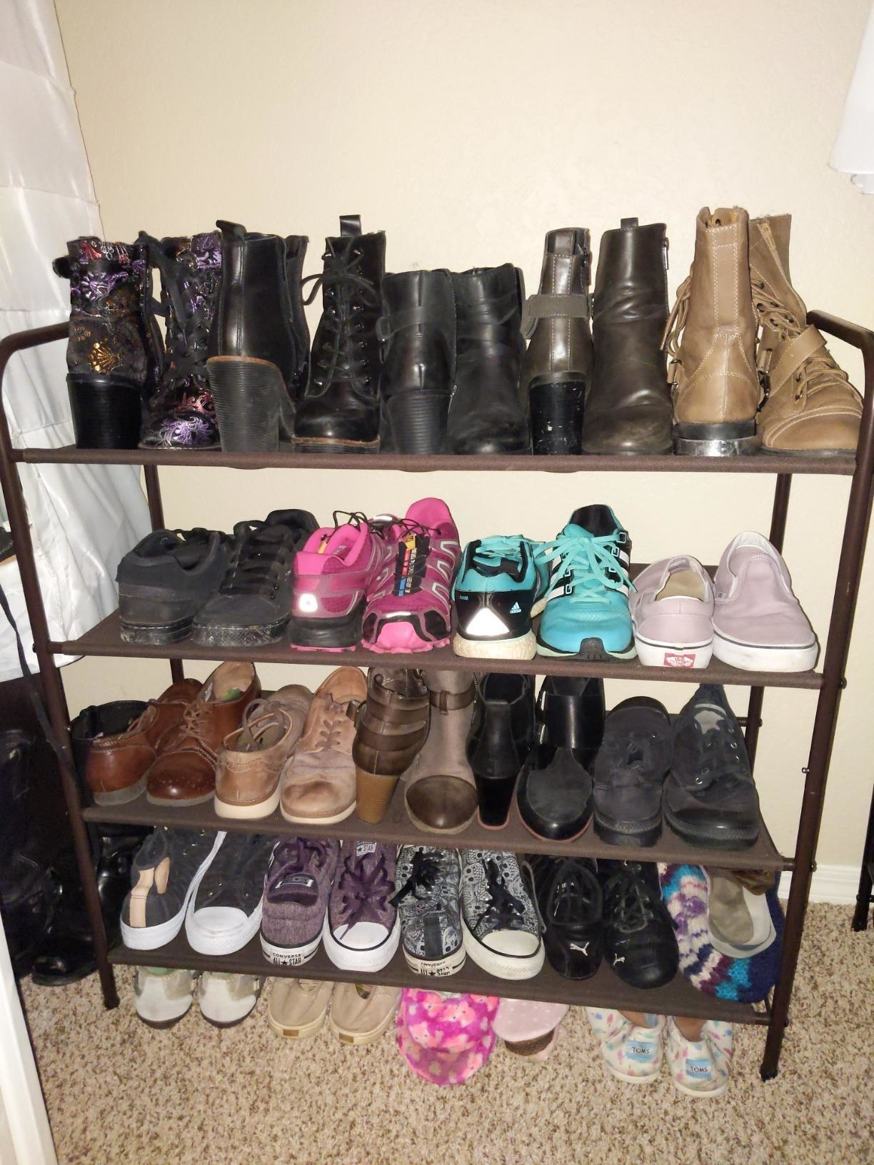 Reviewer uses the rack to organize boots, sneakers, and more footwear in their home