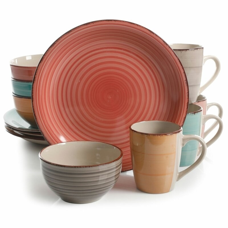 The set, which comes with mugs, small salad bowls, and dinner plates, and has a light spiral pattern on the outer surfaces of the dishes