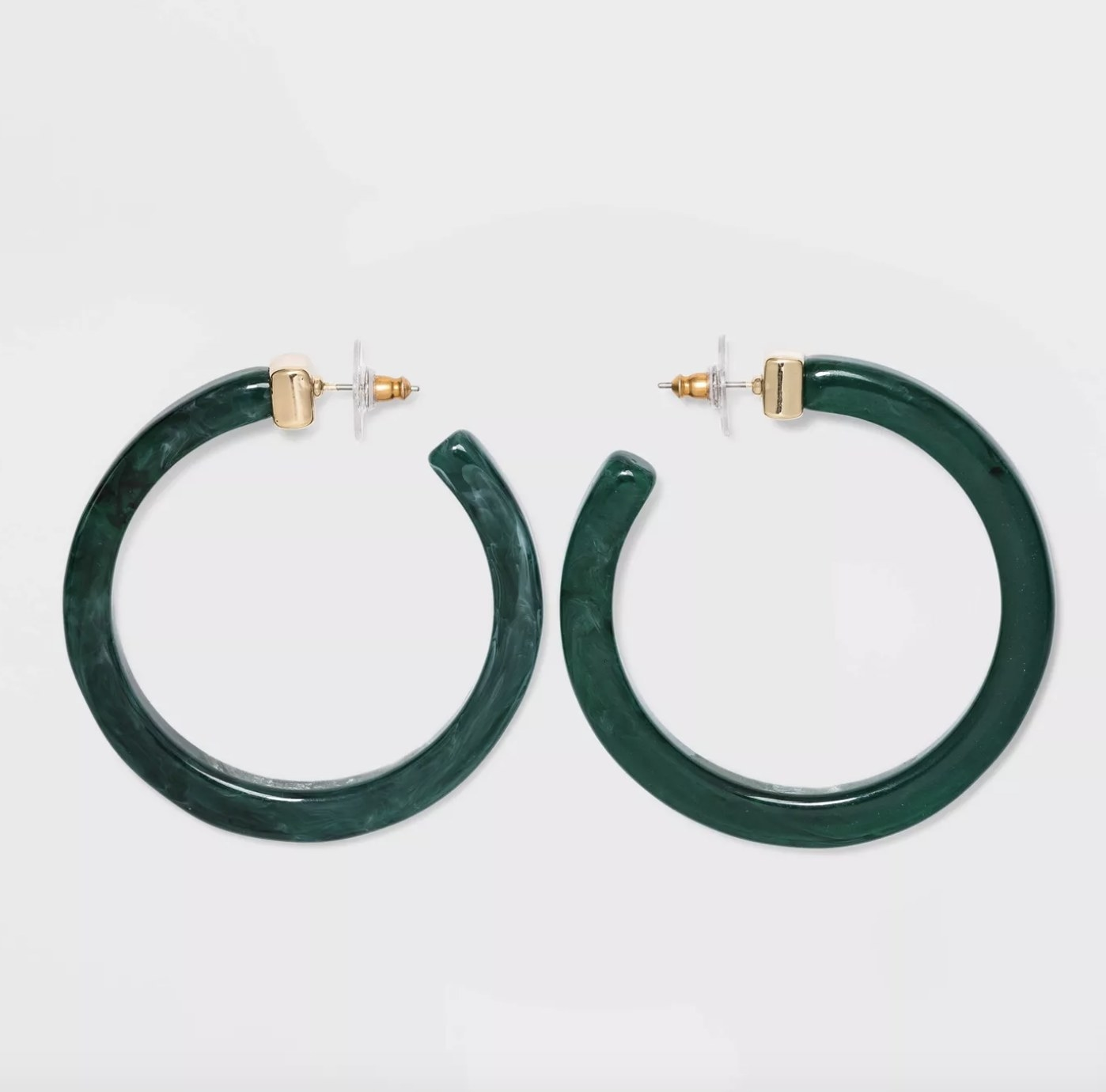 the earrings in green