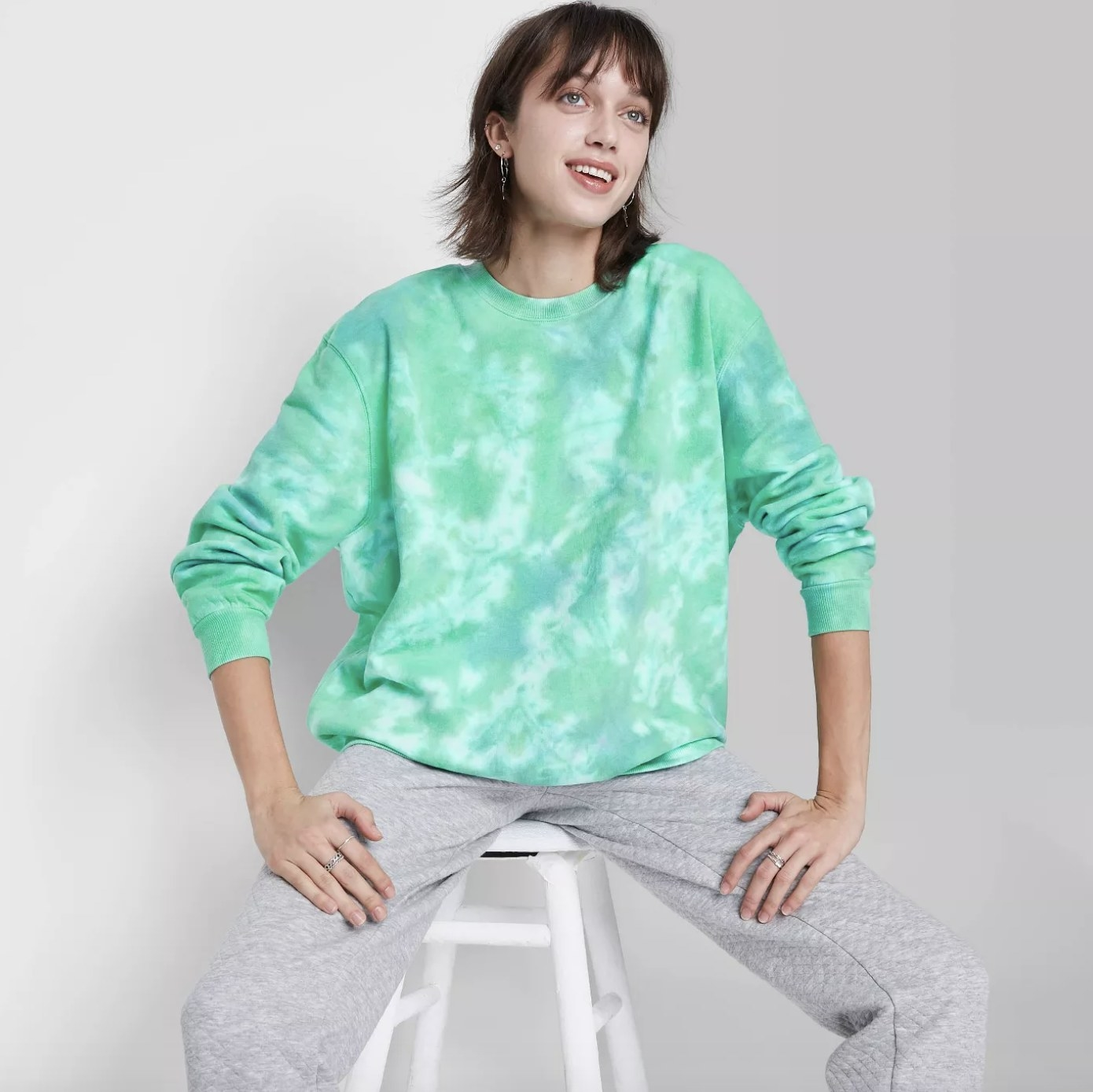 the sweatshirt in blue/green tie dye
