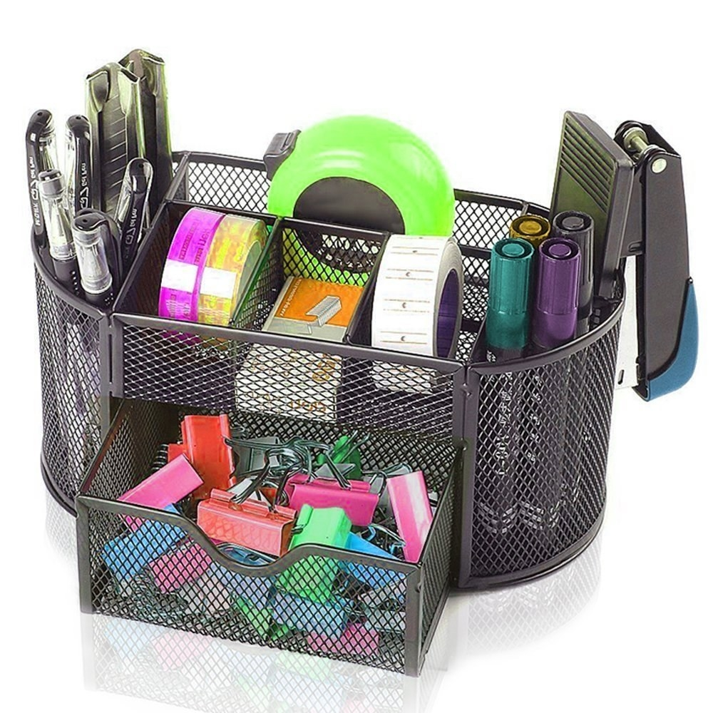 A black wire mesh organiser with stationery in it