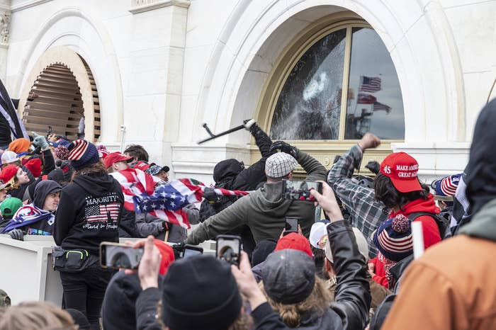 Insurrectionists smash windows at the Capitol