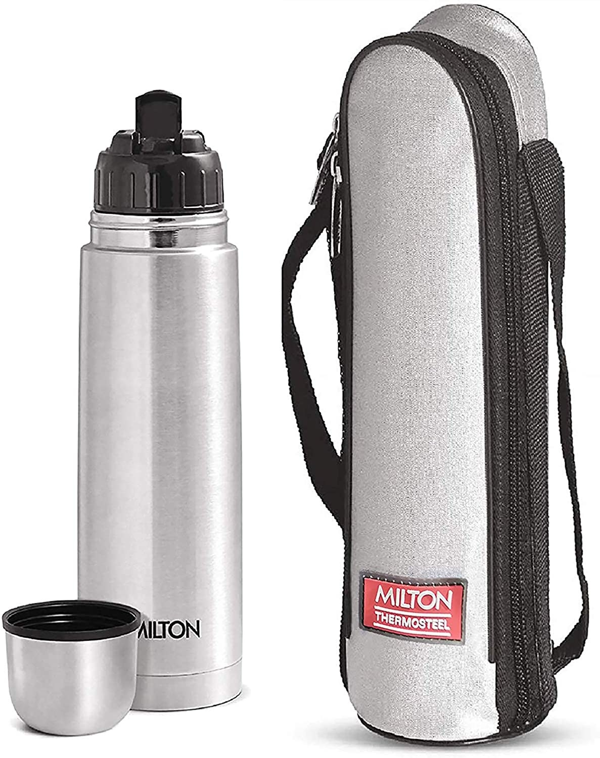 A silver insulated flask next to the packaging