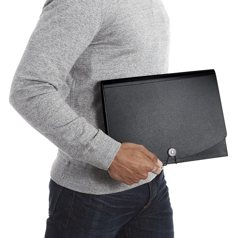 A black folder next to a man in a grey shirt