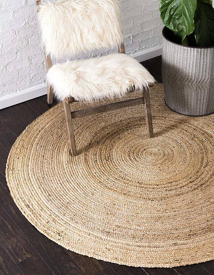 A jute rug on the floor next to a chair