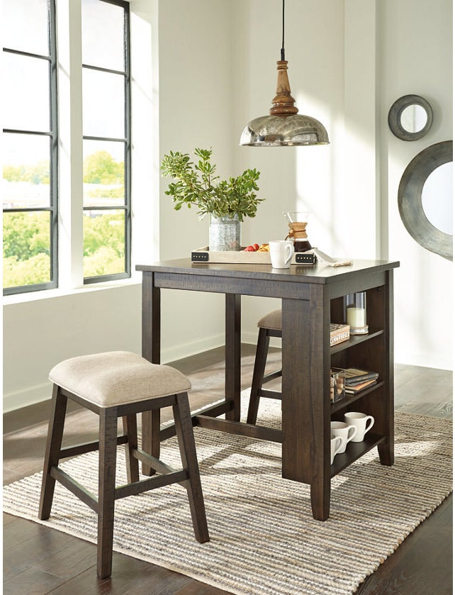 rectangular tall table in brown with three shelves on the end and two coordinating bar stools with fabric seats
