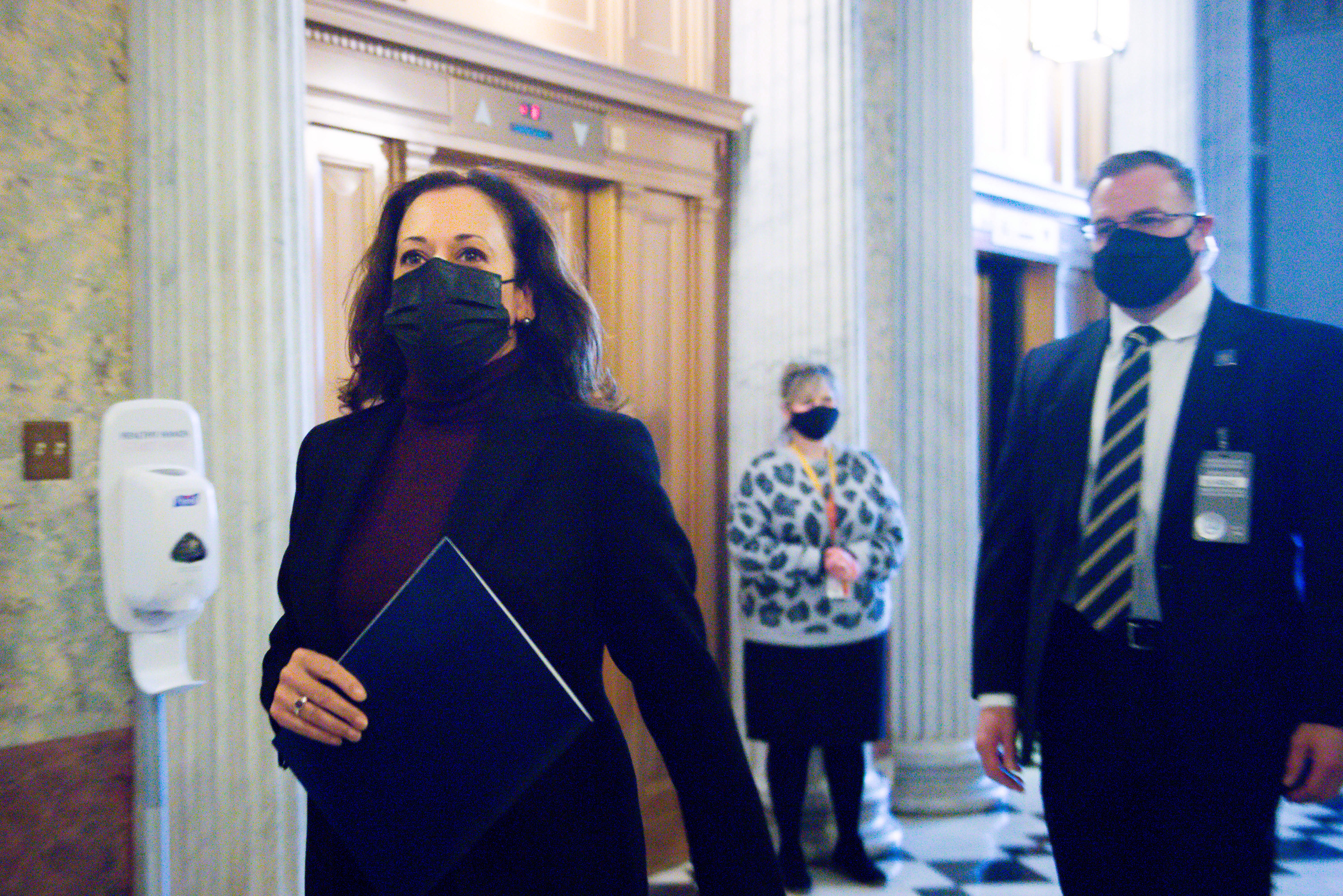 Vice President-elect Kamala Harris arrives at the U.S. Capitol wearing a mask to vote on January 1, 2021 in Washington, DC