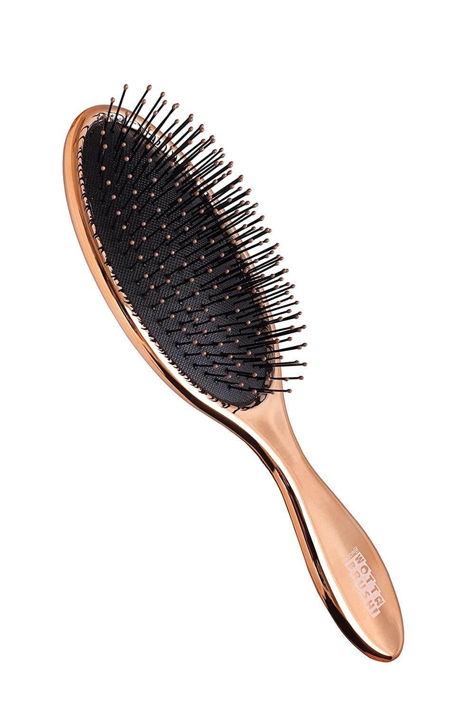 A rose gold hair brush