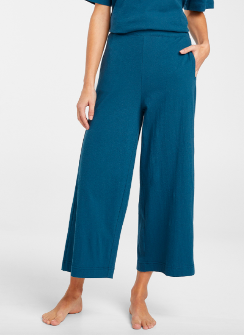 A person wearing the cropped wide leg cotton loungewear pants