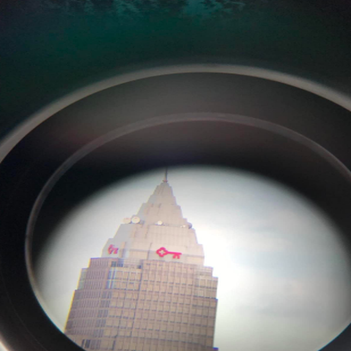 The same reviewer with a closeup image of the top of a building in the skyline, seen through the telescope