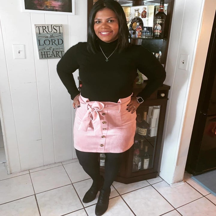 reviewer wearing the skirt in light pink