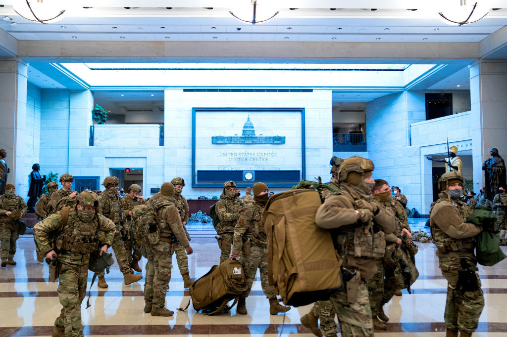 National Guard members in full gear walking through the US Capitol Visitor Center