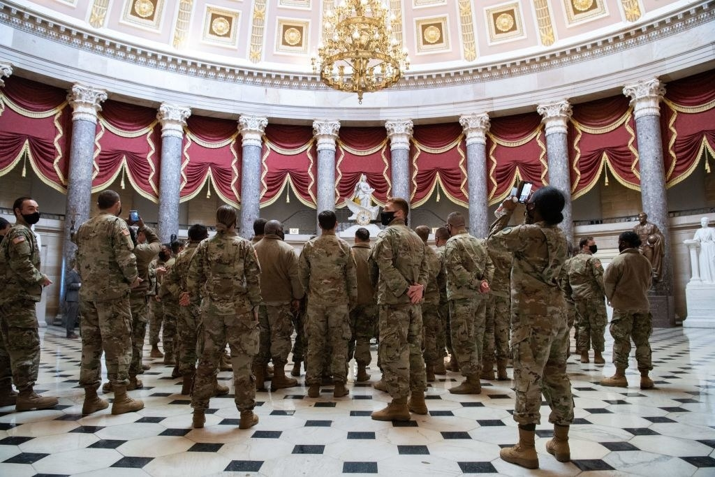 National Guard members standing in a rotunda inside the Capitol