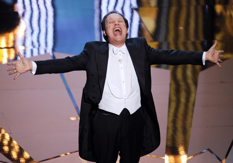 Billy Crystal singing onstage