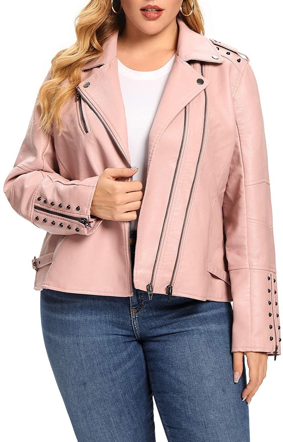 A model wearing the pink jacket with gunmetal hardware