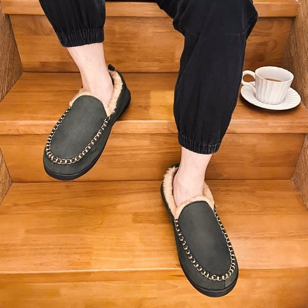 A close-up of the slippers worn by a model