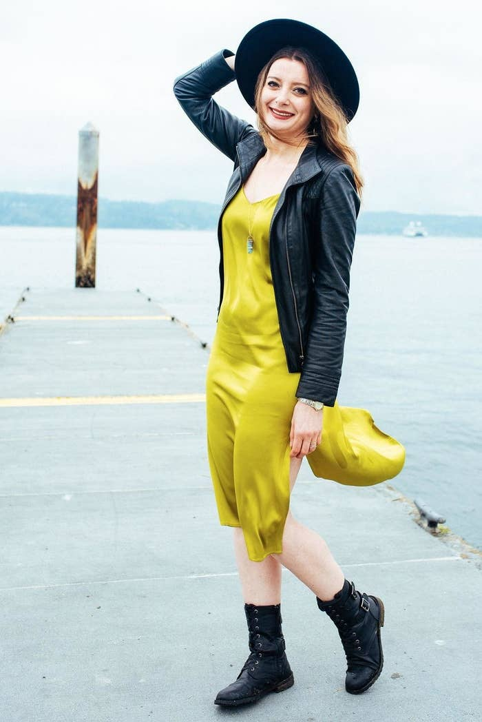 reviewer wearing the v-neck slip dress in yellow