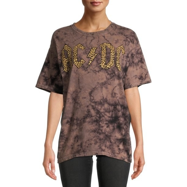 Model in acid wash short sleeve graphic t-shirt