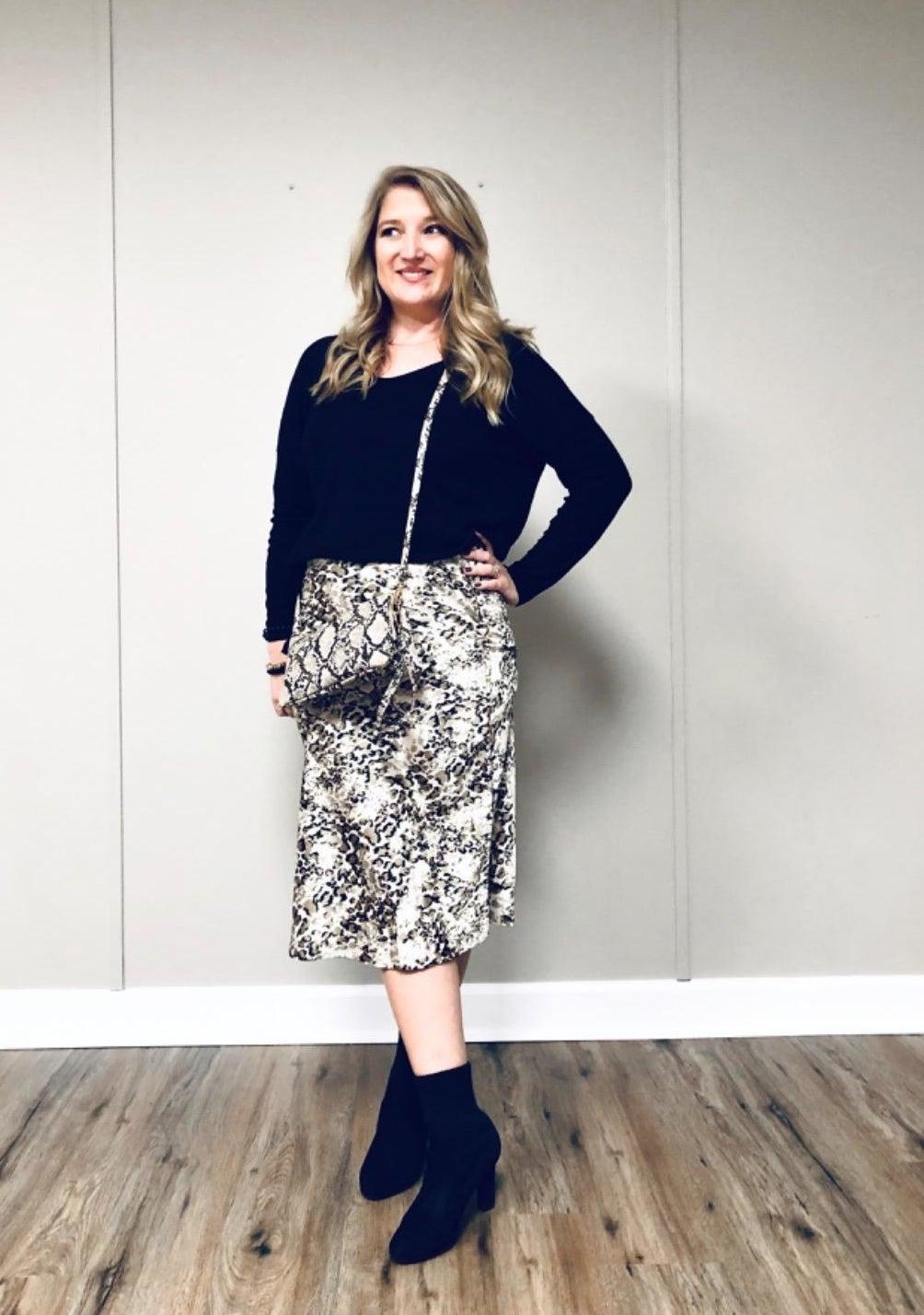 reviewer wearing the slip skirt in white and black snakeskin print