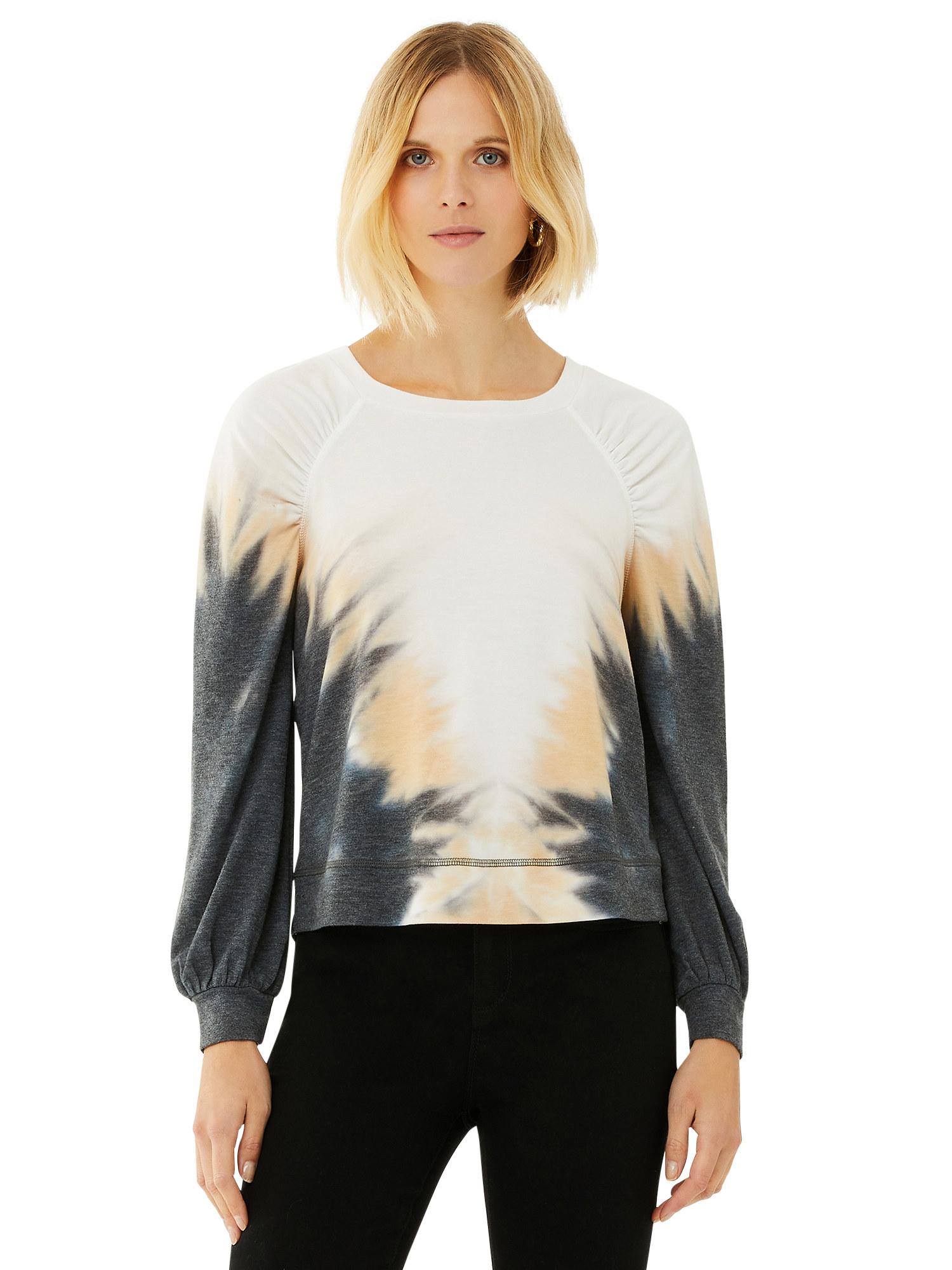 Model in tie dye sweatshirt with balloon sleeves