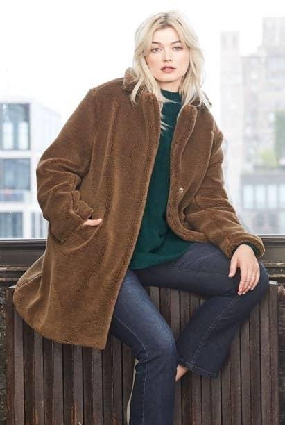 Model in teddy faux fur coat