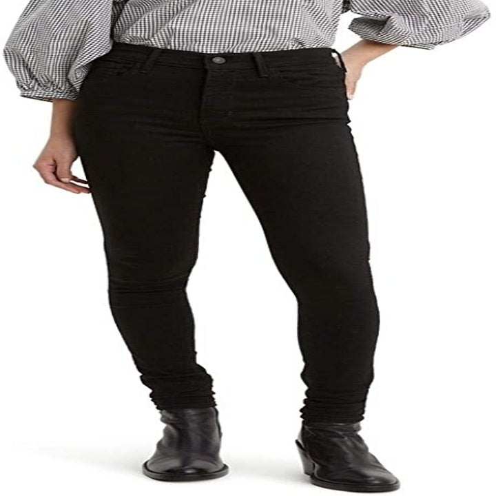 Front view of a model wearing the black jeans