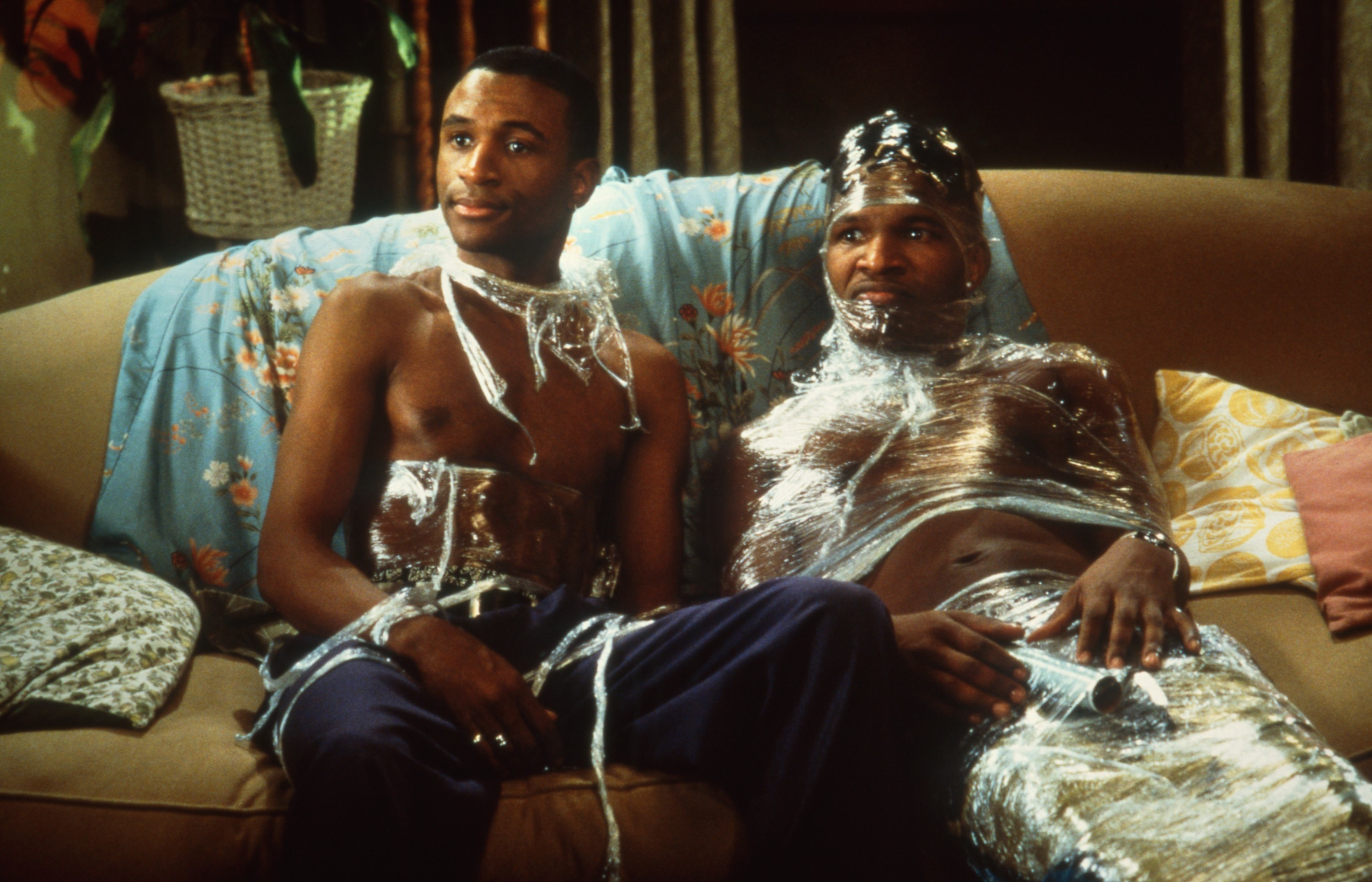 Jamie Foxx wrapped in kitchen plastic wrap on the couch