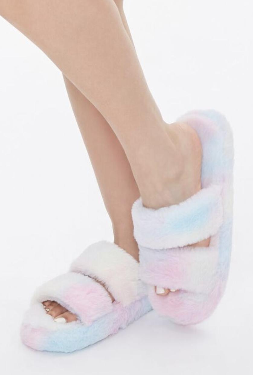 Model in faux fur pastel tie dye slippers with open toes