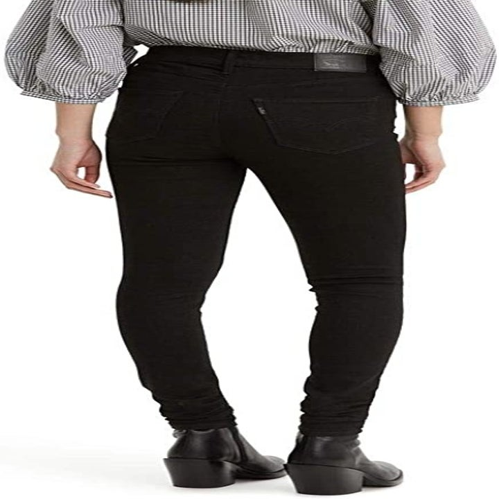 Back view of a model wearing the black jeans