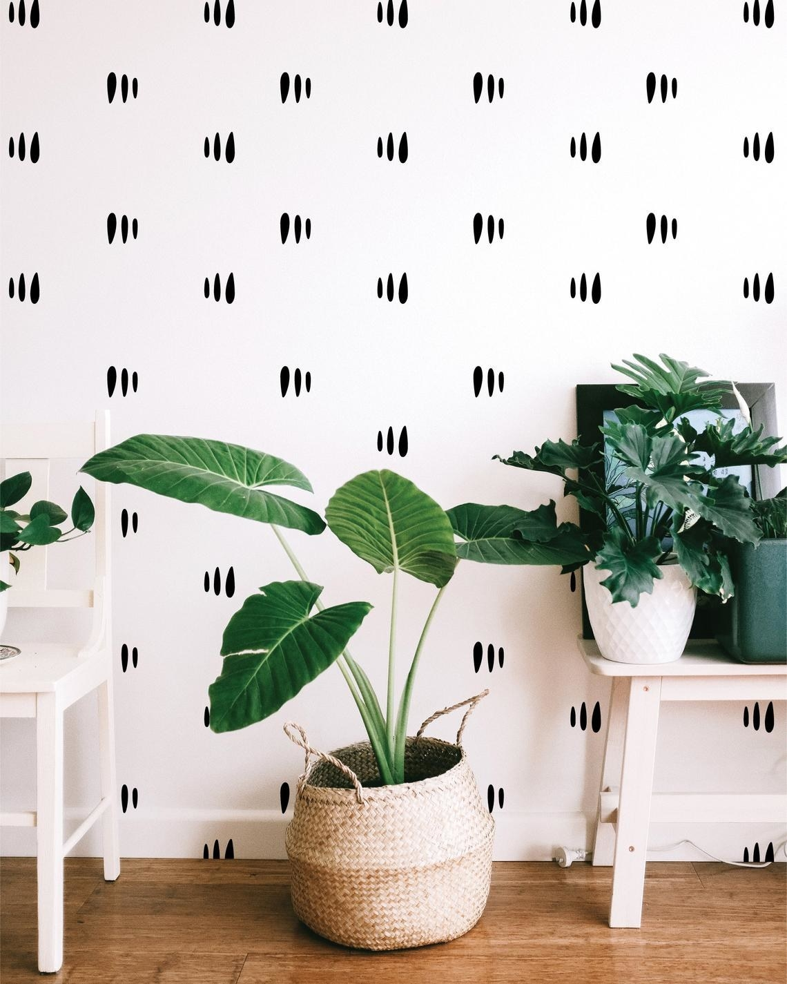 The decals on a wall behind plants